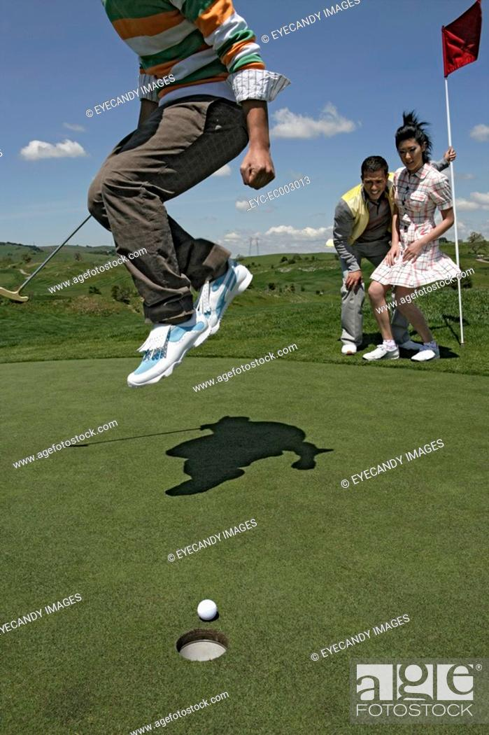 Stock Photo: View of a man jumping in excitement.