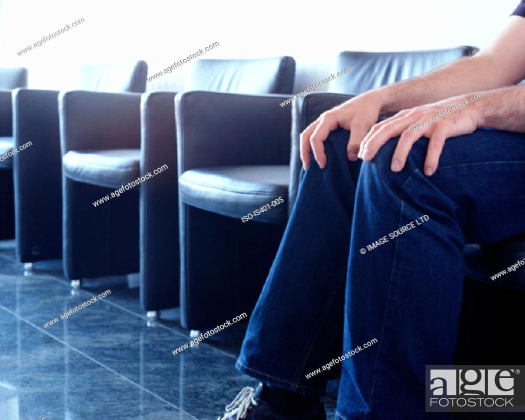 Stock Photo: Man sitting in hospital waiting room.