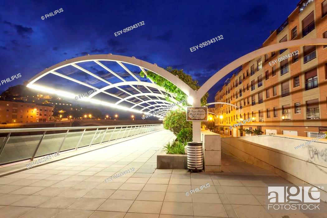 Stock Photo: Promenade at the Guadalentin river in Lorca illuminated at night. Province of Murcia, southern Spain.