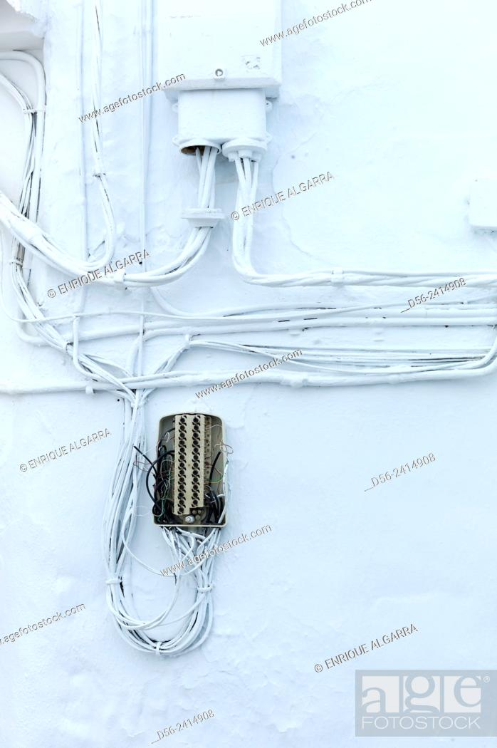 Imagen: White wall with electric wires, Frigiliana, Malaga province, Andalucia, Spain.