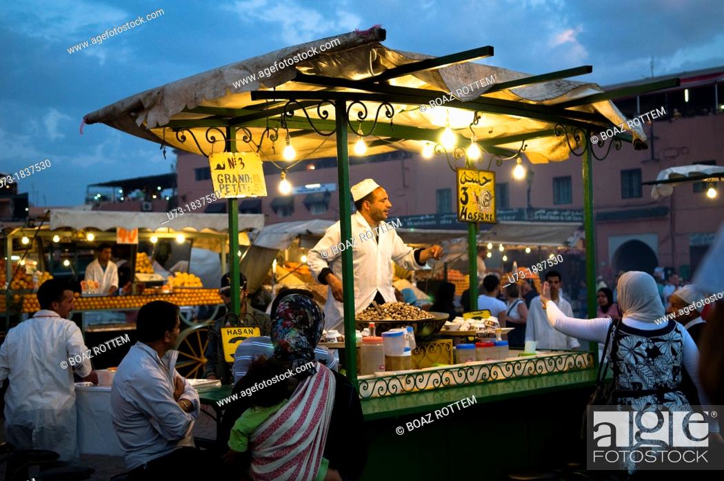 Stock Photo: A local snails food stall at the night market in Marrakesh's Djema el fna sq.