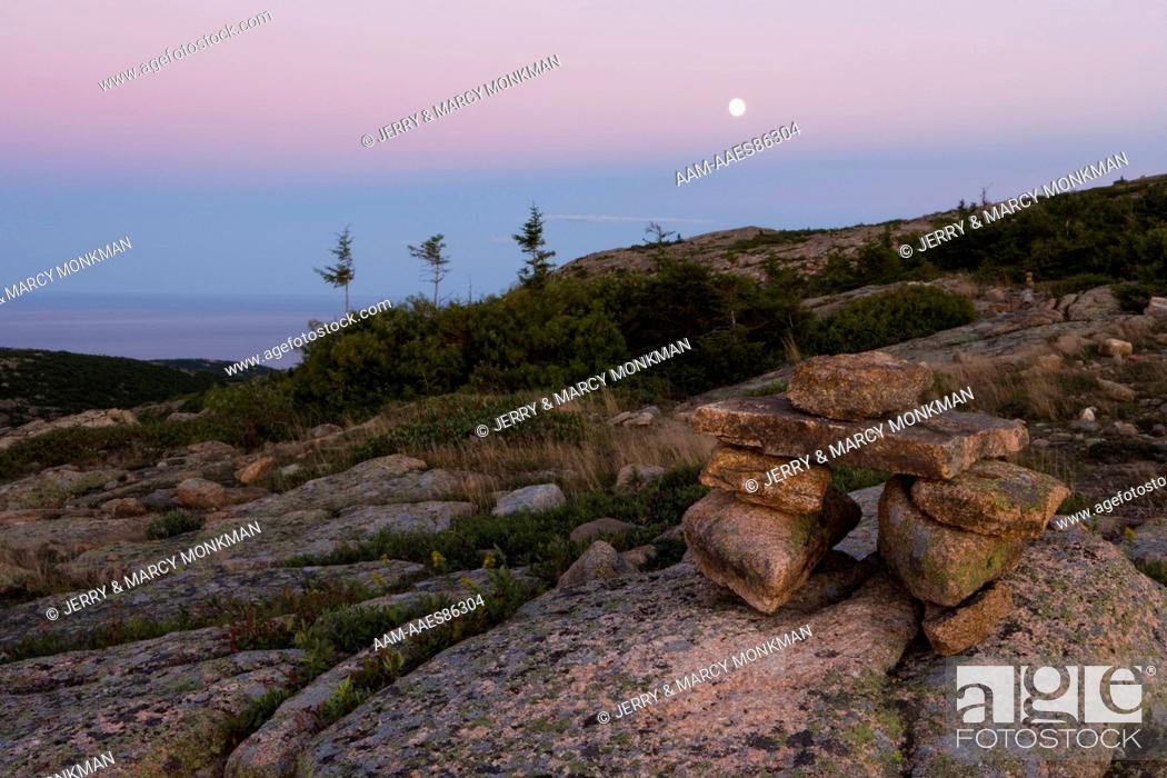 the moon rises as night falls on the north ridge trail on cadillac