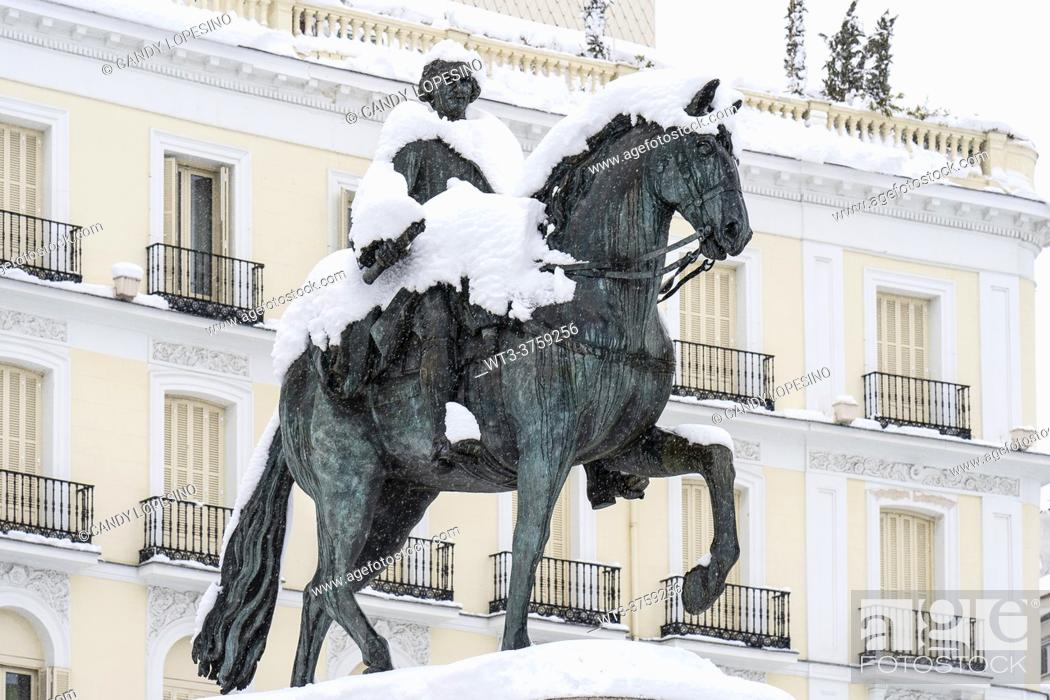 Stock Photo: January 9, 2021, statue of Carlos III in the Plaza Puerta del Sol after Storm Filomena brought intense snow, MADRID, SPAIN, EUROPE.