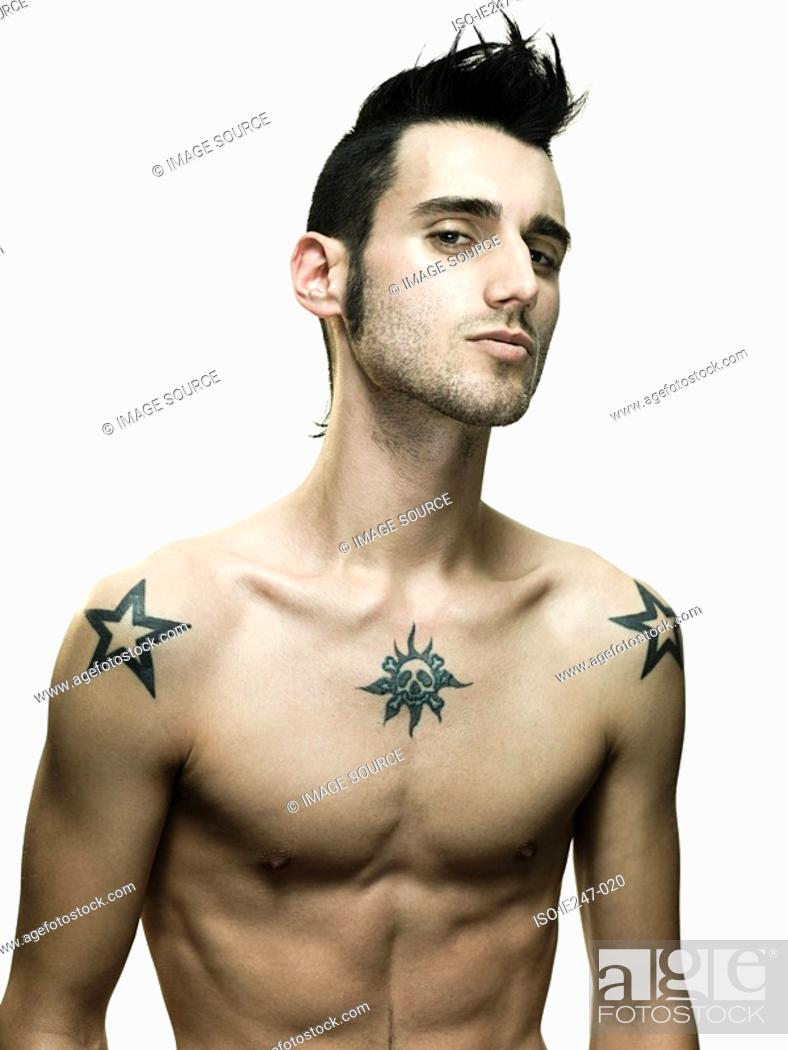 Stock Photo: Young man with tattoos.