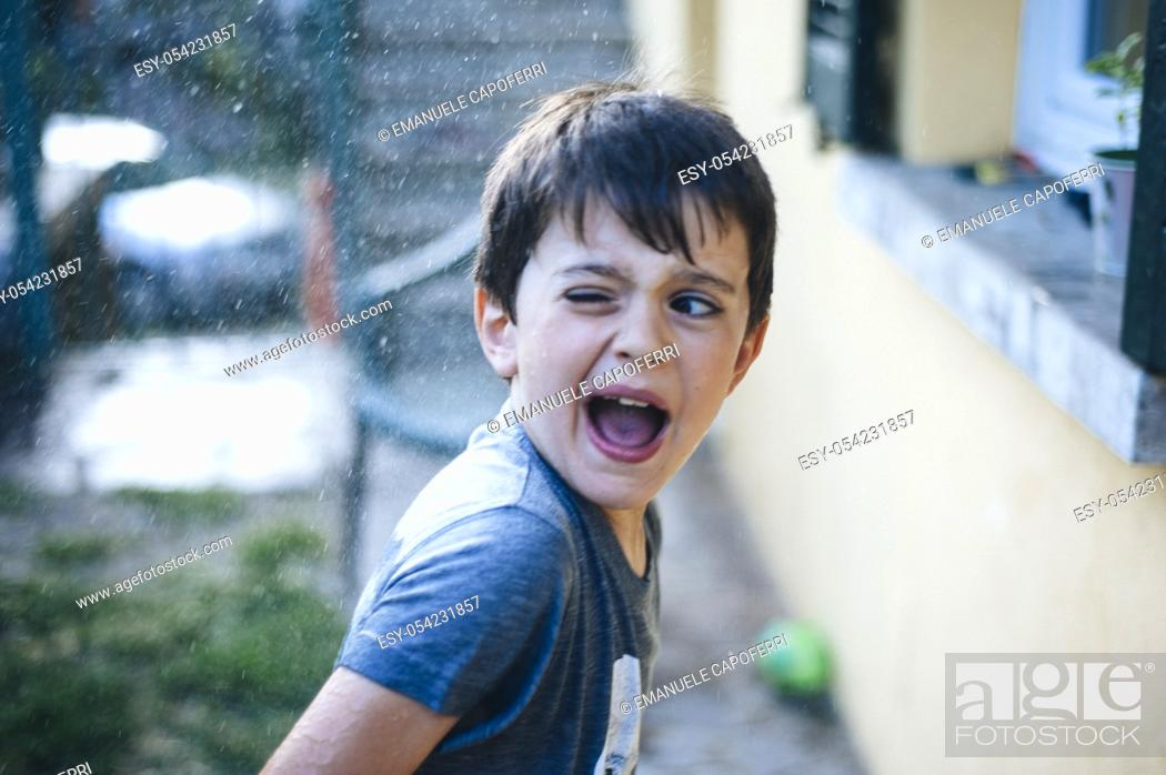 Stock Photo: Boy soaked by water gun. Italy.