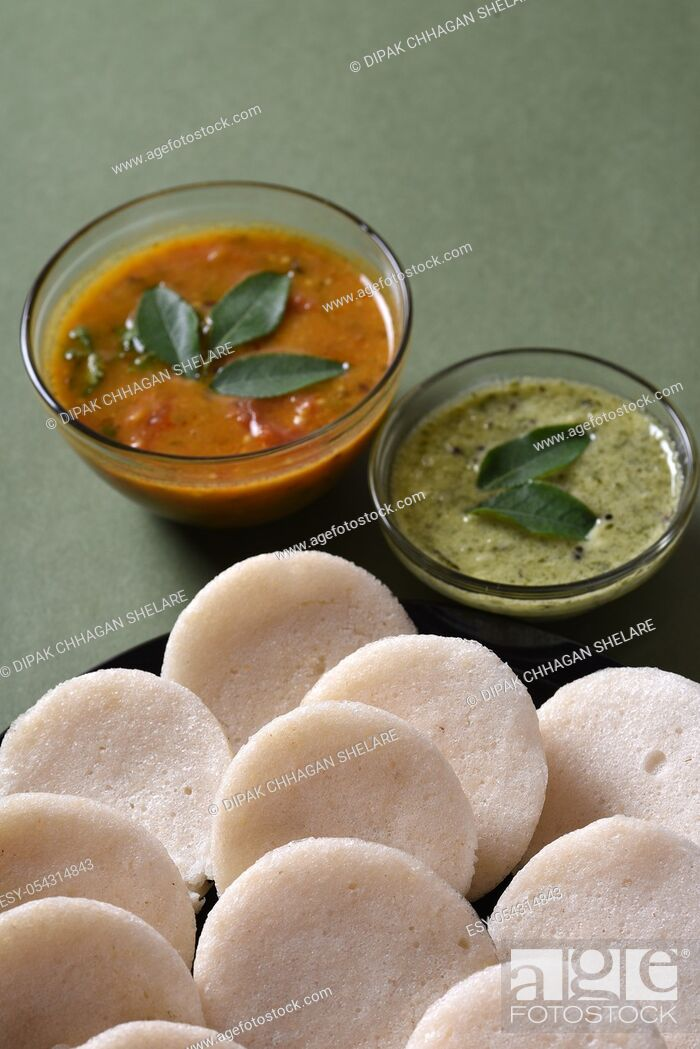 Stock Photo: Idli with Sambar and coconut chutney, Indian Dish : south Indian favourite food rava idli or semolina idly or rava idly, served with sambar and green chutney.