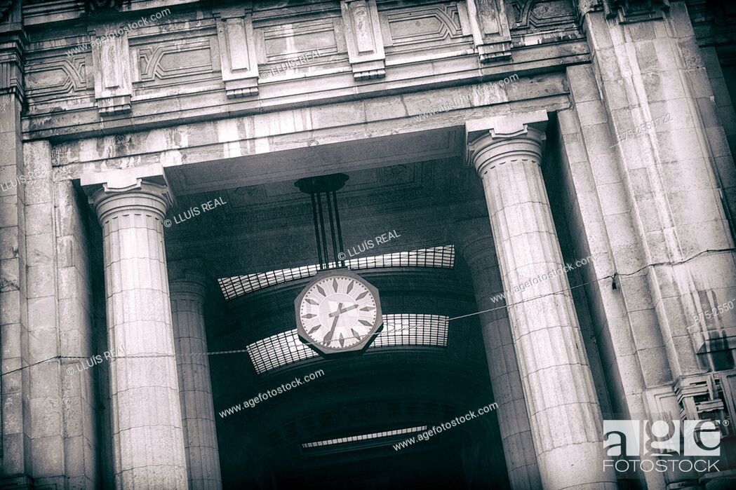 Stock Photo: Clock ticking 2:35 p.m., in the building of the railway station of Milan, Italy, Europe.