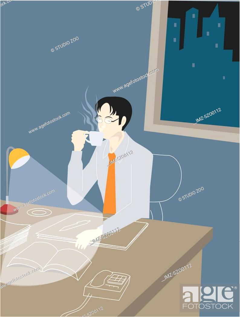 Stock Photo: Businessman working late into the night and drinking coffee.