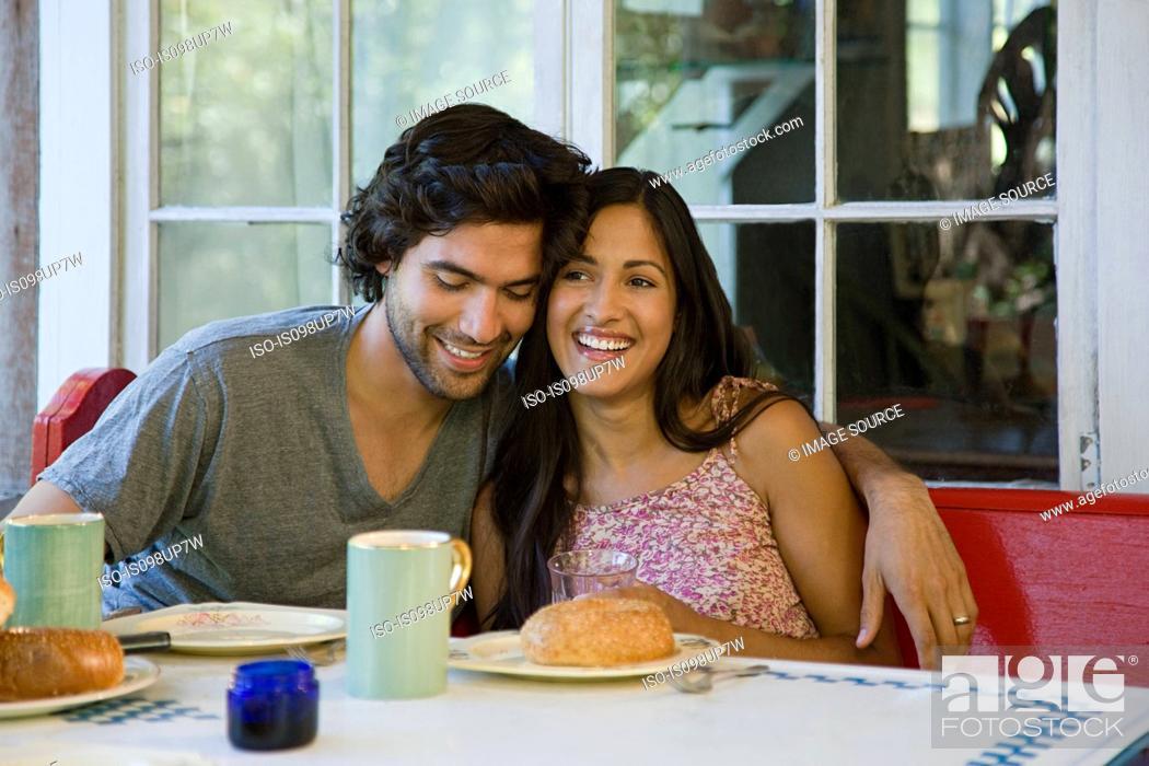 Stock Photo: Happy couple at breakfast.