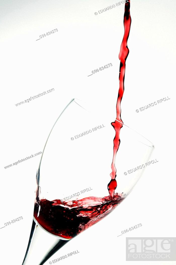 Stock Photo: Wine pouring into a wineglass.