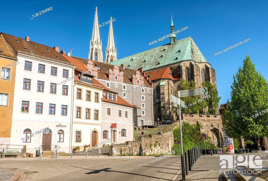Stock Photo: Neisse River waterfront and Peterskirche in the background, Goerlitz, Saxony, Germany.