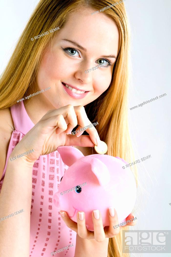 Stock Photo: portrait of woman with a piggy bank.