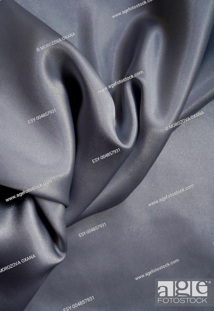 Stock Photo: Smooth elegant grey silk as background.