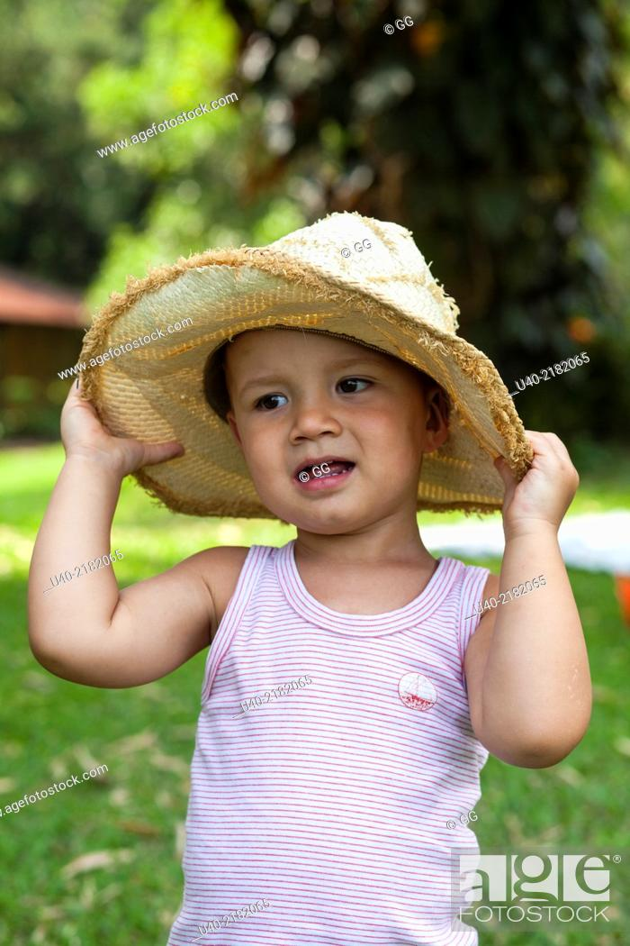 Stock Photo  2 year old boy outdoors with cowboy hat. 10e33d2e8e8