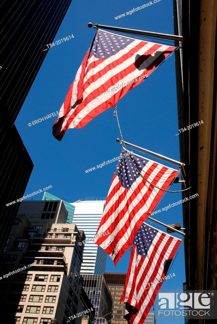 Stock Photo: Three U.S. flags at a Tower in Manhattan.