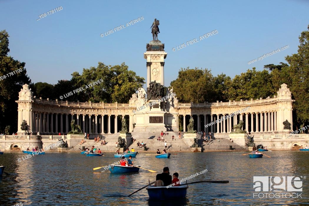 Stock Photo: Tourists enjoying the boats in Retiro Park Pond with its monument and statue of Alfonso XII, Madrid, Spain, Europe.