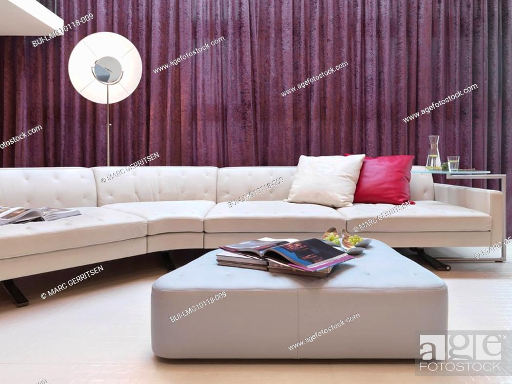 Stock Photo: Large white leather sofa in modern interior.