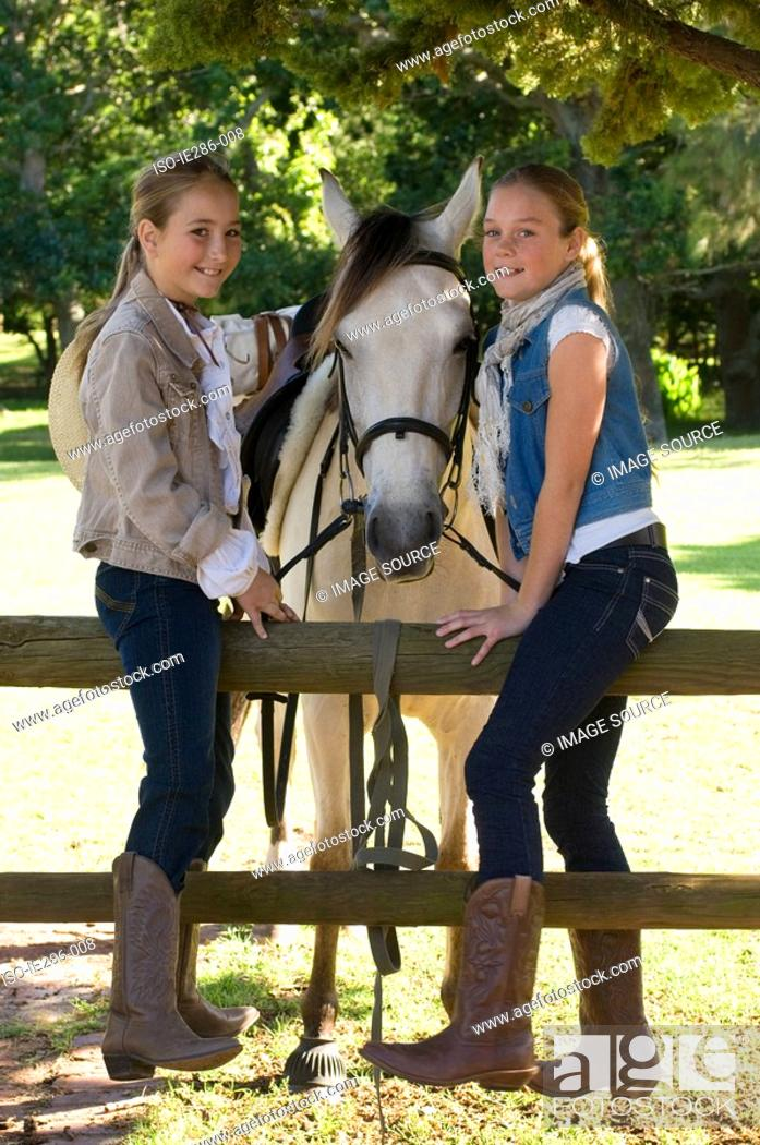 Stock Photo: Portrait of two girls and a horse.