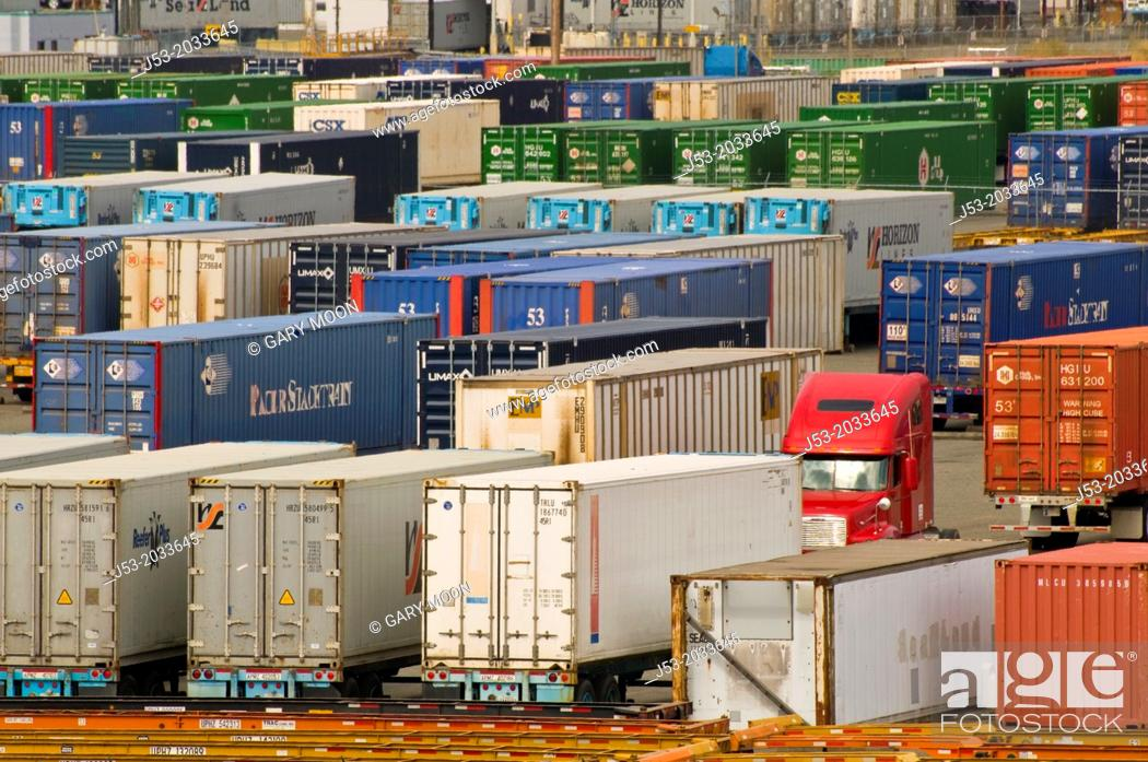 Stock Photo: Cargo containers on trailers, parked at container ship terminal, Port of Tacoma, Washington.