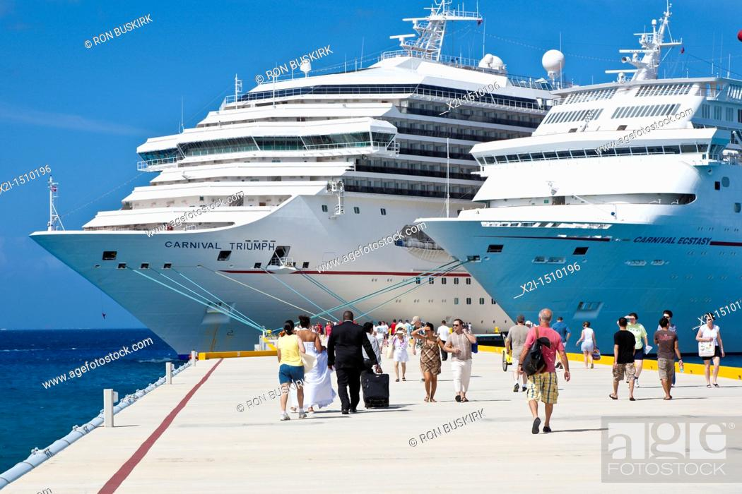 Stock Photo: Cruise ship passengers including a just married couple in wedding dress on pier disembarking from Carnival cruise ships Triumph and Ecstasy in Cozumel.