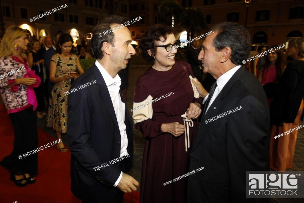 Stock Photo: Roberto Benigni and wife Nicoletta Braschi, Carlo Fuortes arrive at the Premiere of theatrical performance ' Waiting for the Sibyl ' at Opera Theatre of Rome.