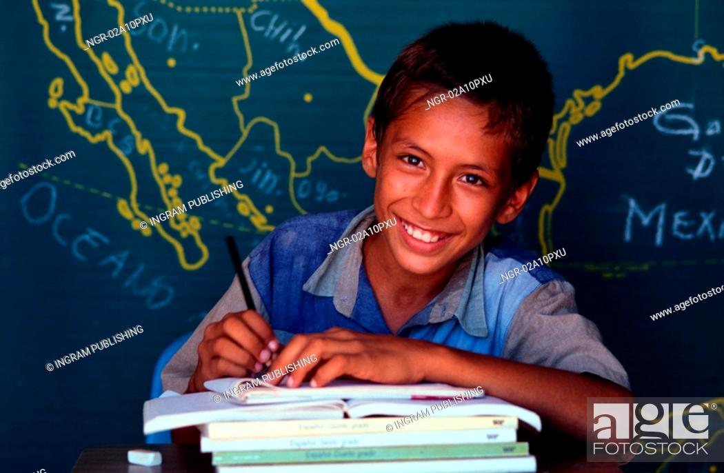 Stock Photo: young boy studying at class.