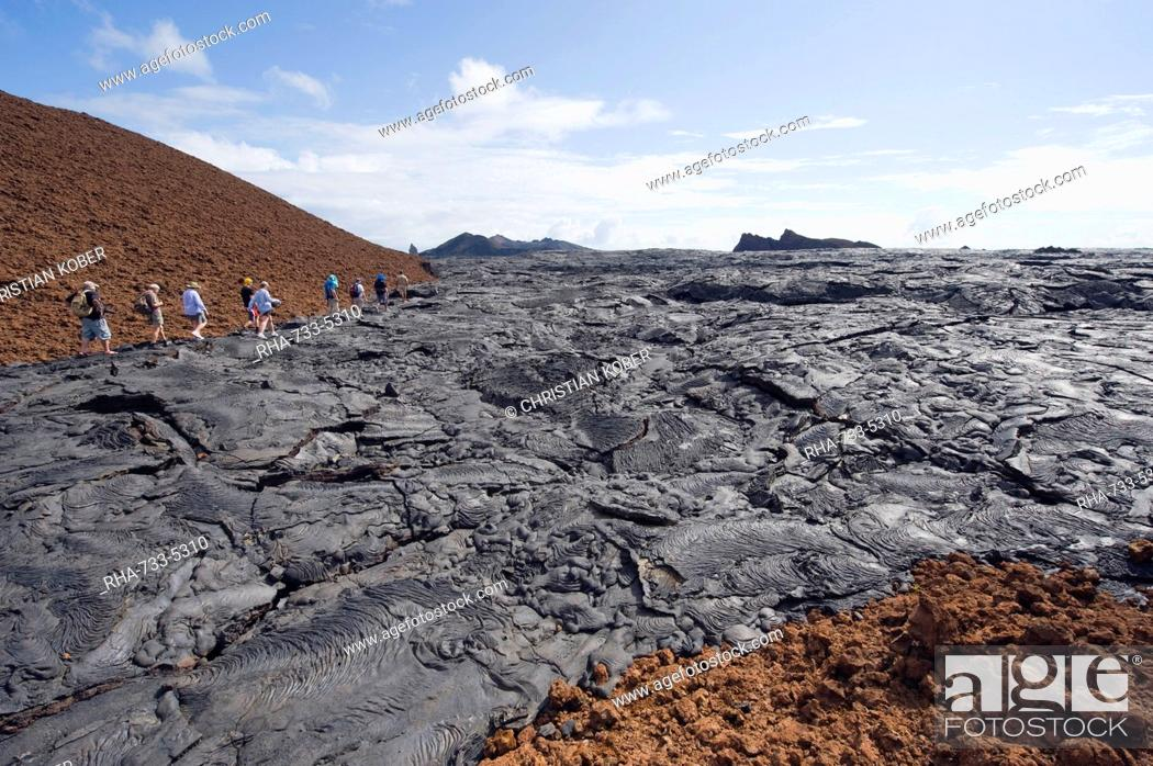 Stock Photo: Tourists walking on lava flow on Isla Santiago, Sullivan Bay, Galapagos Islands, UNESCO World Heritage Site, Ecuador, South America.