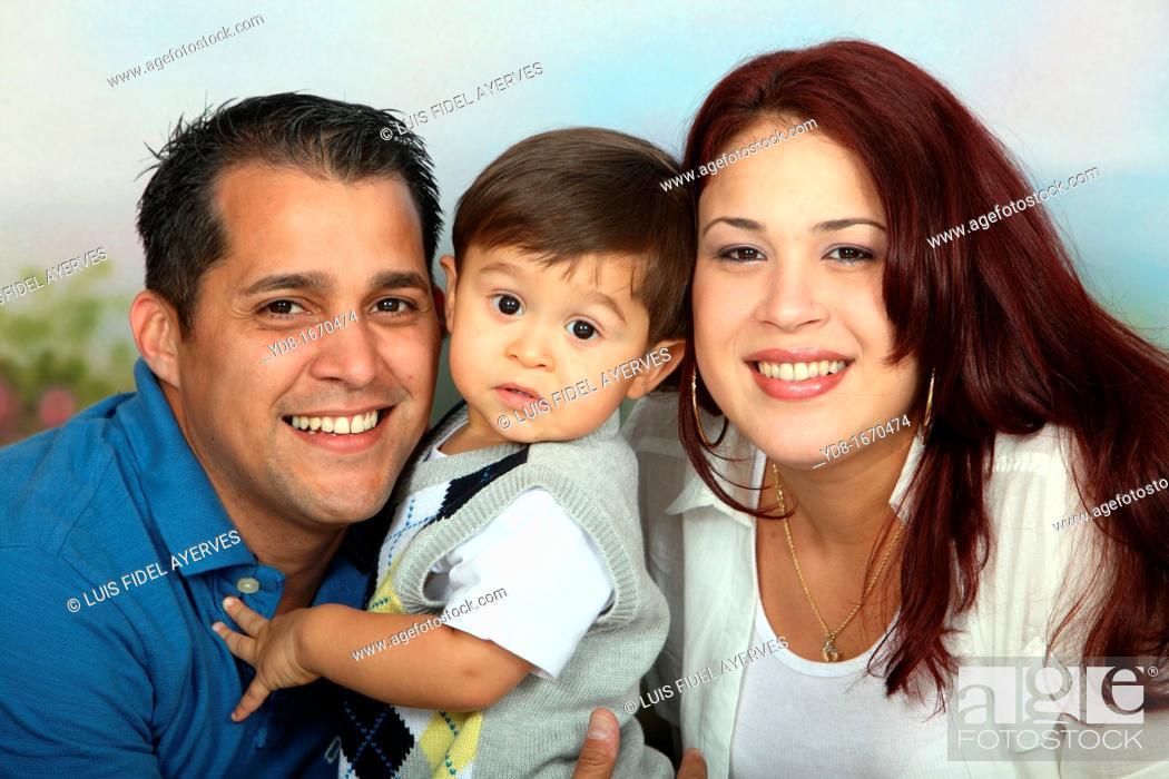 Stock Photo: Happy family posing in the Studio.
