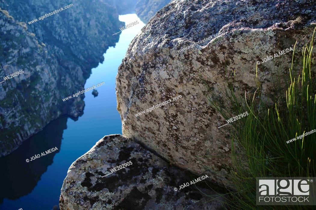 Stock Photo: The Douro river slowly flowing in the narrow cliffs by the Mirandese Plateau.