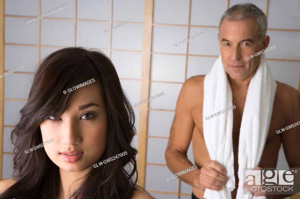 Stock Photo: Portrait of a young woman with her father standing behind her.