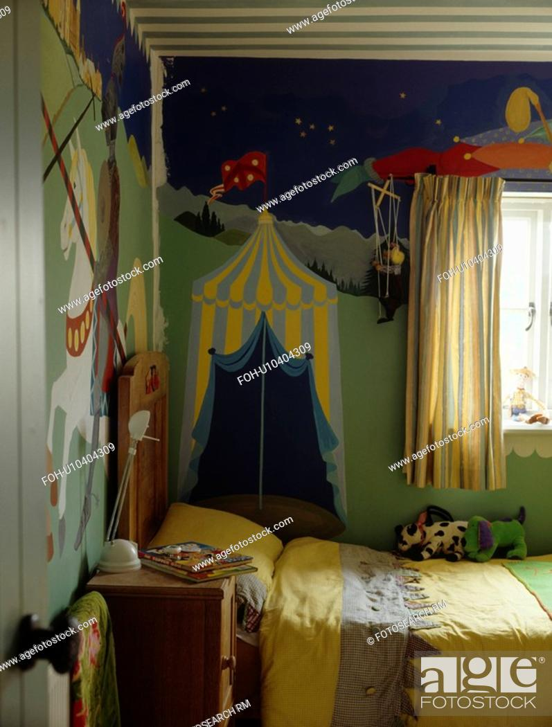 Stock Photo Paint Effect Mural On Wall Of Child S Bedroom With Yellow Bedlinen