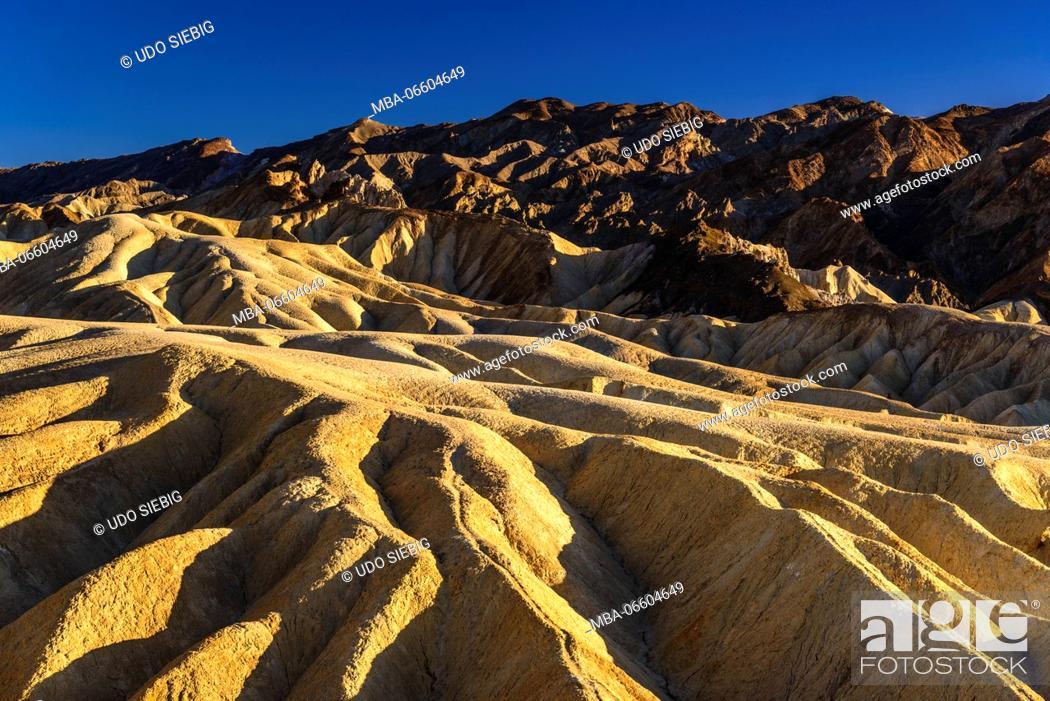 Stock Photo: The USA, California, Death Valley National Park, Zabriskie Point, badlands.