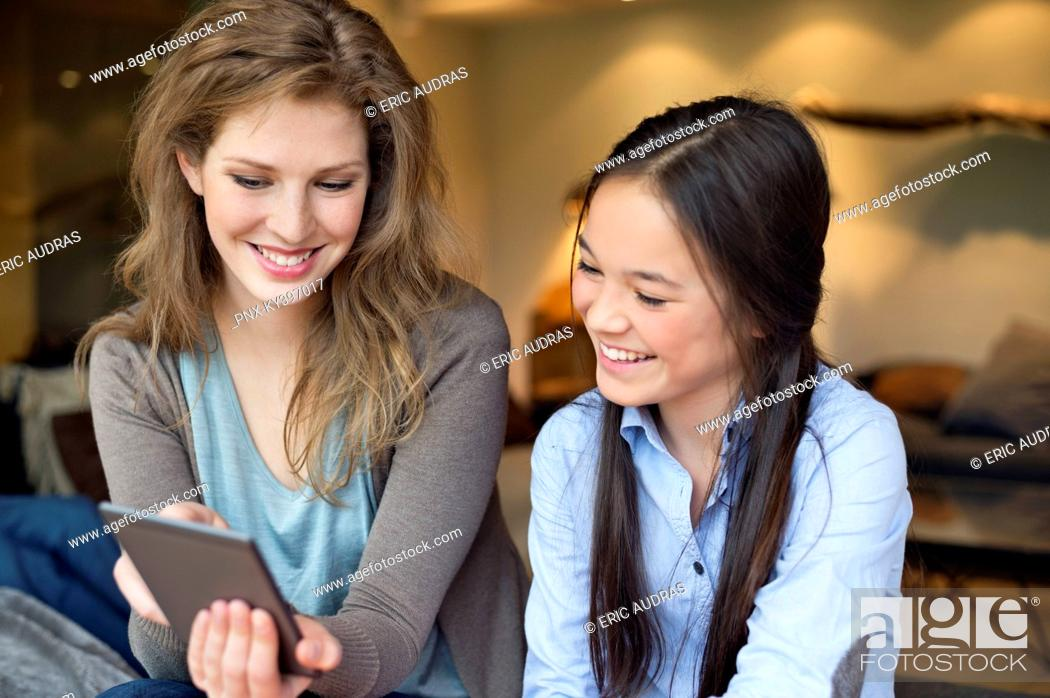 Stock Photo: Woman with her daughter using digital tablet.