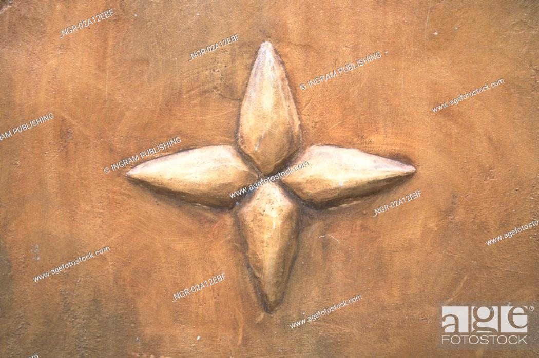 Stock Photo: Close-up of a star embossed on a wall.