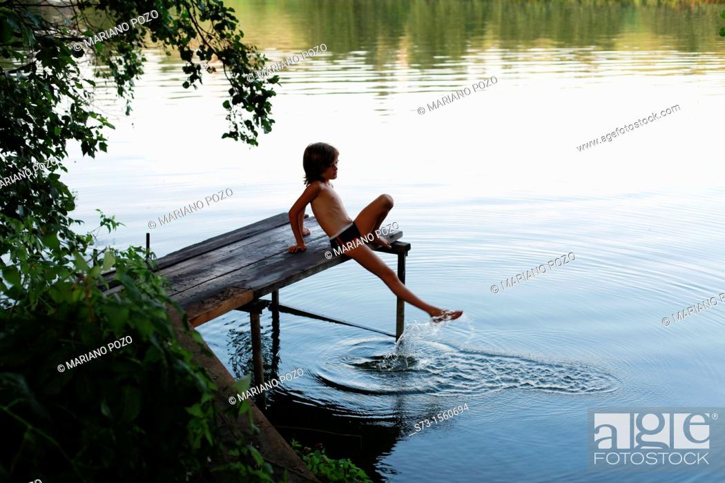 Stock Photo: Girl on the pier in Lake Avral, Kirillovka, Samara Region, Russian Federation.