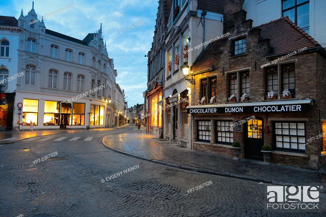 Stock Photo: Brugge street and Dumon chocolatier in the morning.
