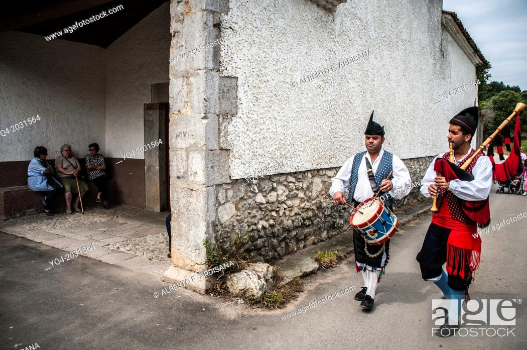 Stock Photo: Pipers coming to the chapel of Our Lady of the Snows. Llanes. Asturias. Spain.