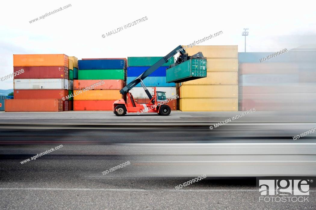 Stock Photo: Truck lifting shipping containers.