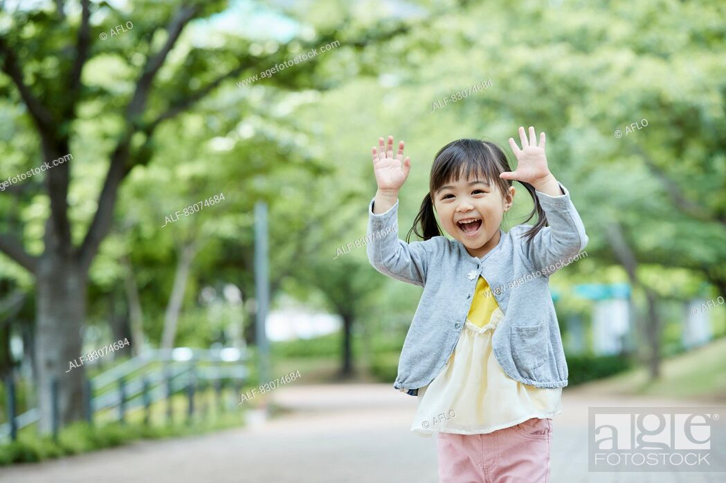 Stock Photo: Japanese kid in a city park.