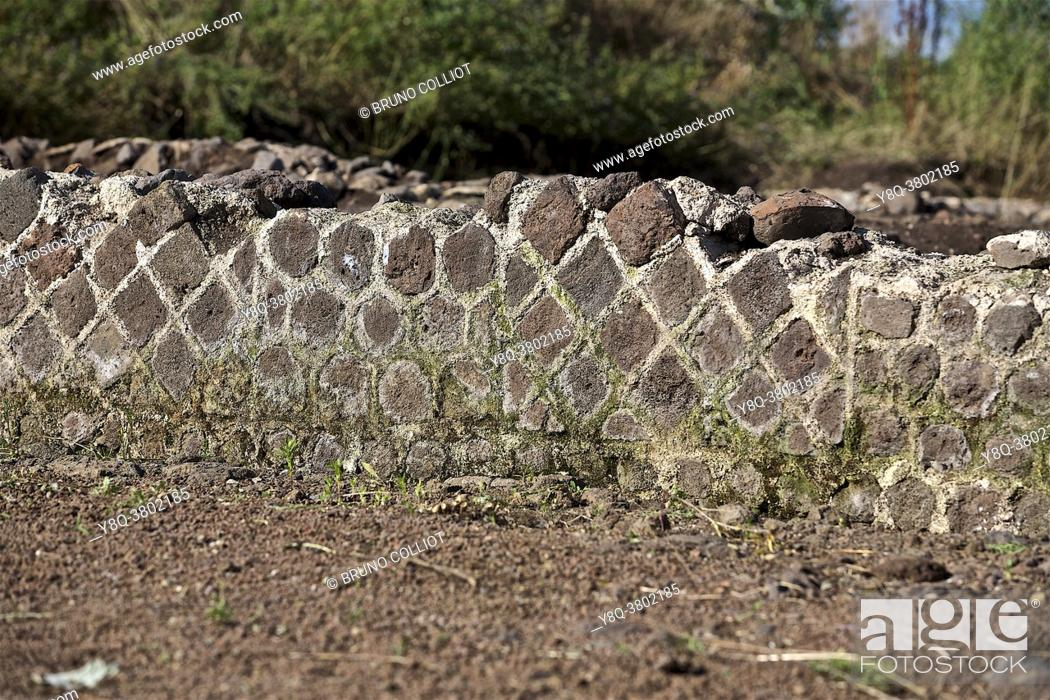 Stock Photo: refurbished sanctuary of the Gallic oppidum of corent, mosaic. puy de dome, france. . The oppidum of Corent, also called the oppidum du Puy de Corent.