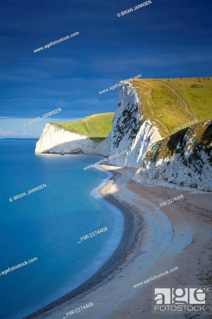 Stock Photo: Sunrise over the cliffs of the Jurassic Coast near Durdle Door, Dorset, England.