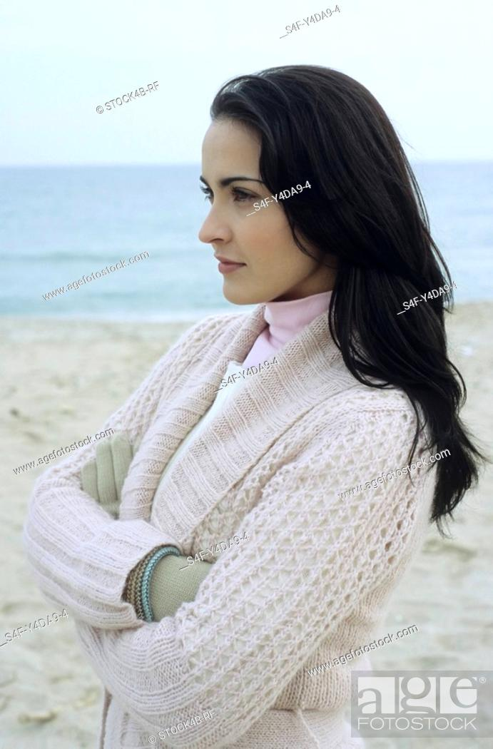 Stock Photo: Young brownhaired Woman with Cardigan at the Beach - Season - Nature.