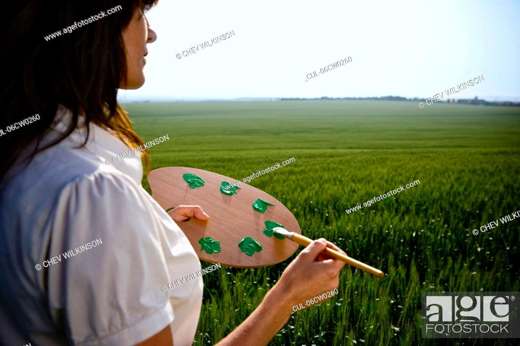 Stock Photo: Woman holding painters palette.