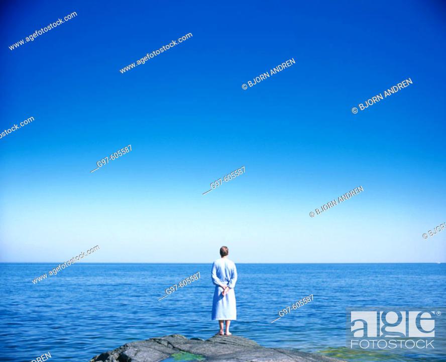 Stock Photo: Man looking at the sea.