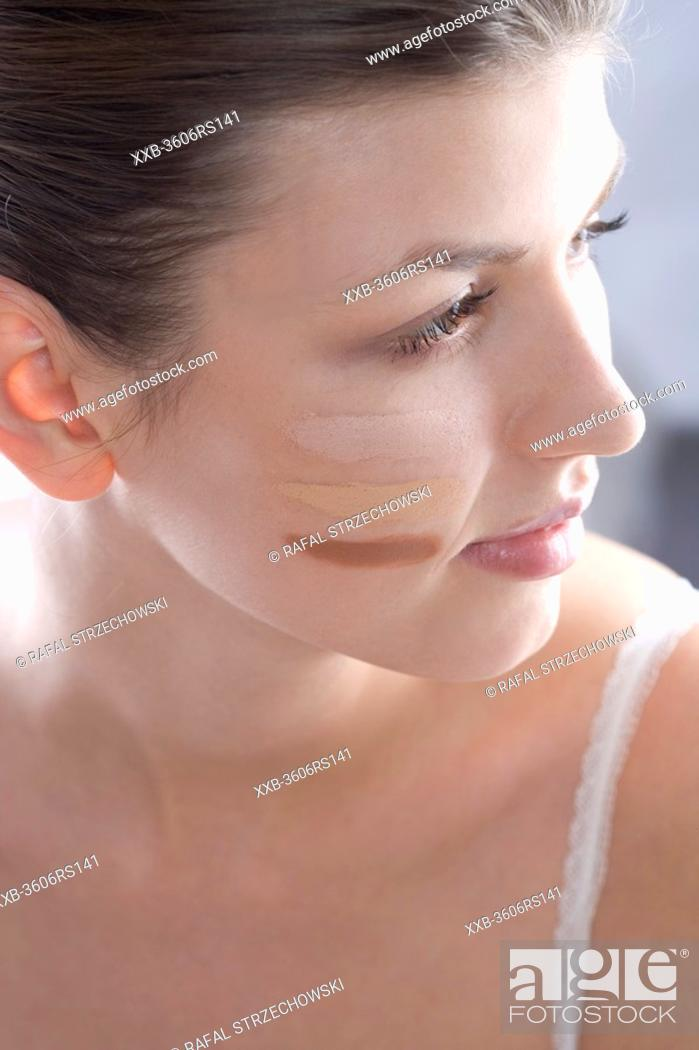 Stock Photo: woman with make up on face.