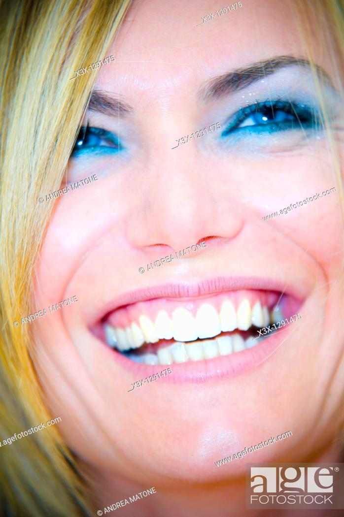 Stock Photo: Portrait close-up of woman laughing.