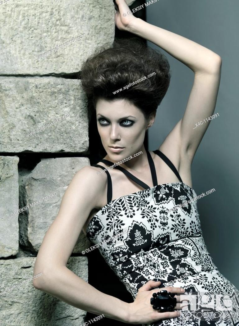 Stock Photo: High fashion photo of a beautiful woman wearing elegant dress.