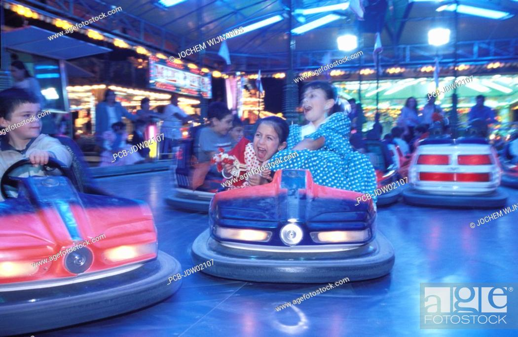 Stock Photo: Jerez de la Frontera, girls in flamenco dress in dodgem during the Feria del caballo.