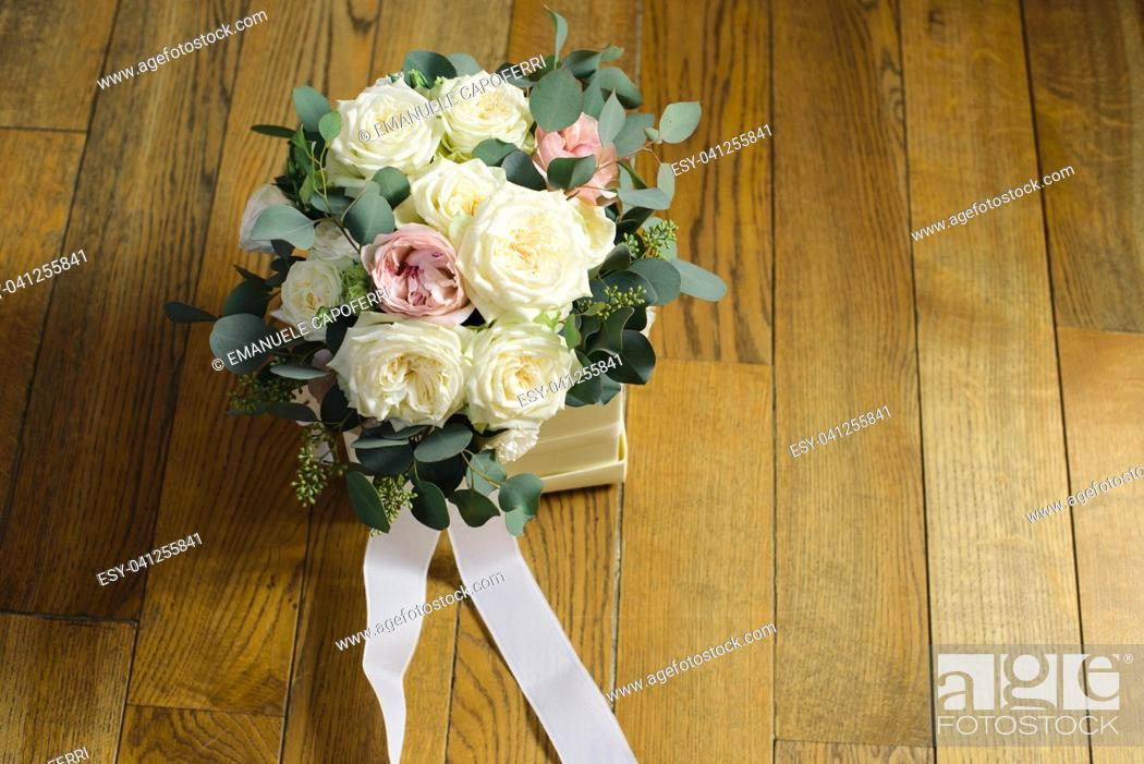 Stock Photo: wedding bouquet of flowers with white roses and pink peonies.