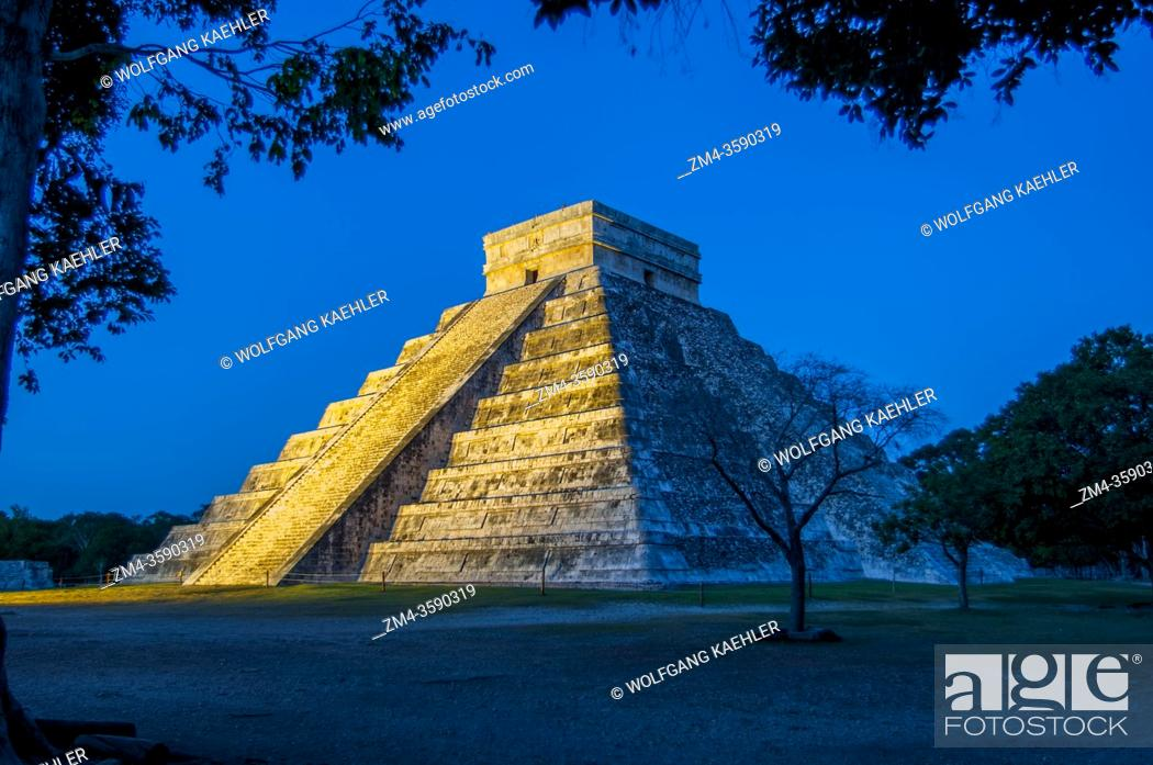 Stock Photo: View of El Castillo (Temple of Kukulcan), the great Mayan pyramid, at night during the sound and light show in the Chichen Itza Archaeological Zone (UNESCO.
